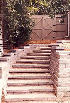custom stone patio stairs and gate built